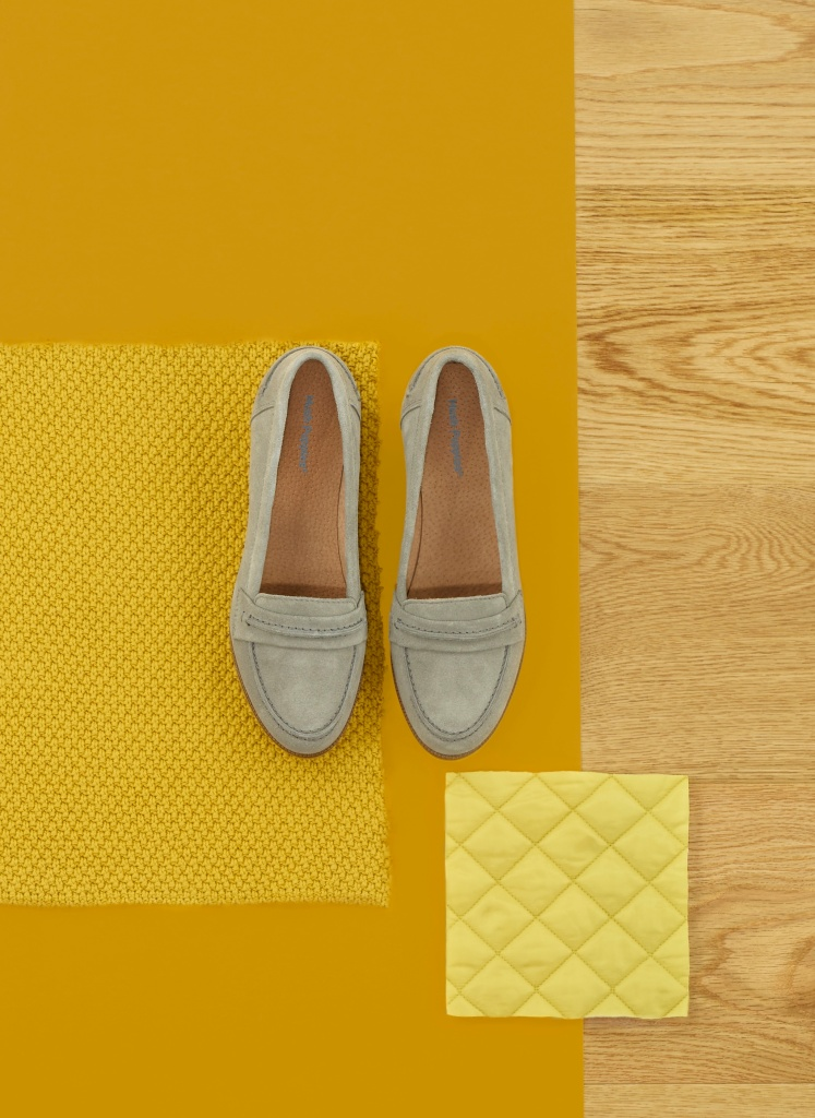 grey hushpuppies on yellow